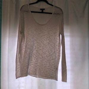 A thin, white, and knitted sweater